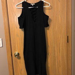 Bodycon black dress with deep neckline